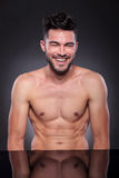 Naked young man laughs hard Stock Photo