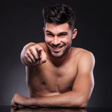 Naked young man points at you Royalty Free Stock Photo