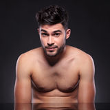 Naked young man with raised eyebrows Stock Photography