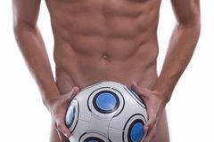 Naked young soccer player with ball stock image