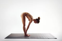 Naked young woman doing exercise on white Royalty Free Stock Photos