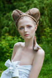 Naked young woman with fashion hairstyle and big snail Stock Photos