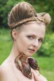 Naked young woman with fashion hairstyle and two big snails Royalty Free Stock Photography