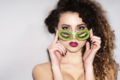 Naked young woman in fruit glasses Royalty Free Stock Images