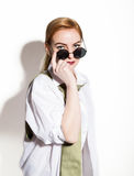 Naked young woman in a man`s white shirt with green tie holding glasess Stock Photo