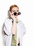 Naked young woman in a man`s white shirt with green tie holding glasess Royalty Free Stock Photo