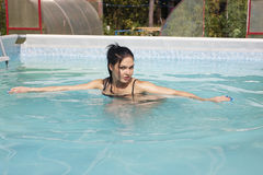 Nude girl in the pool. Naked young woman in the pool at the cottage Stock Photos