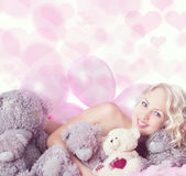 Naked young woman with toy bears Stock Image