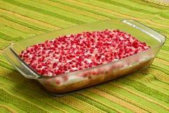 Naken kaka med granatäpplen Arkivfoto