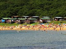 Nakhodka.Primorsky kray / Russia - August 17 2018:Crowded summer beach with beach houses and cars stock photography