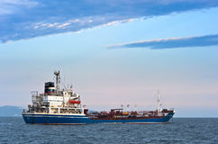 Nakhodka, Russia - August 5, 2015: Tanker Ostrov Russkiy anchored in the roads in Nakhodka bay. Stock Photography