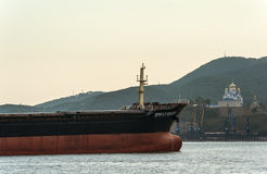 Nakhodka. Russia - June 03, 2016: The bow of a huge bulk carrier Great River at anchored in the roads. Royalty Free Stock Photography