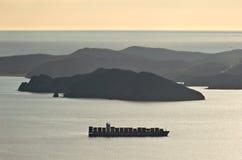 Nakhodka. Russia - March 24, 2016: Container ship companies COSCO anchored in the bay of Nakhodka. Royalty Free Stock Photo