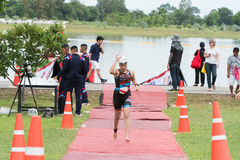 Nakhon nayok,Thailand - 25 June 2017: Woman swimmer run from poo. L to transition area in Challenge Nakhon Nayok 2017 stock photo