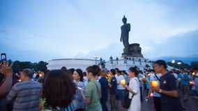 NAKHON PATHOM - July 19:Time-lapse  Day to Night Asalha Puja Day, Buddhists holding lit candle and walk around Big Buddha for Wors stock video