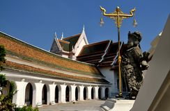 Nakhon Pathom, Thailand: Wat Phra Pathom Chedi. NAKHON PATHOM, THAILAND: Statue of a Chinese soldier overlooks the circular cloister gallery and west Vihara royalty free stock images