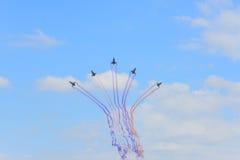 NAKHON RATCHASIMA 27 NOVEMBER :The display of aerobatics shared. The aerobatics show celebrating the 40th anniversary relationship Thailand - China's Gripen and Royalty Free Stock Photos
