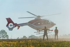 Helicopter landing to carry injured passenger to hospital in rec Royalty Free Stock Photos