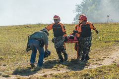 Escue team carrying injured passenger to hospital in recue drill Royalty Free Stock Photos