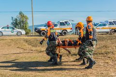 Rescue team carrying injured passenger to hospital in recue dril Royalty Free Stock Photos