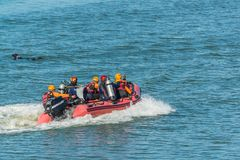 Rescue team running boat to help paasenger falled into swamp in Royalty Free Stock Image