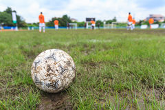 Nakhon Ratchasima, Thailand - October 1 : Muddy soccer ball on a football field in Municipal Stadium Nakhon Ratchasima on October. 1, 2016, in Thailand Royalty Free Stock Photo
