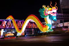 Nakhon Sawan, Thailand - February 5, 2017: Chinese New Year In Many Tourists. The Traffic Light Shows A Dragon. Royalty Free Stock Image