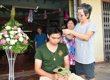 Nakhonnayok-Thailand ,July 3 : Shaved ordained Buddhist ceremony. In Thailand. Thai man gets his head shaved JULY 3 , 2015 : in home,Nakhonnayok, Thailand royalty free stock image