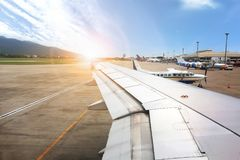 NAKHONRATCHASIMA, THAILAND - MAY 18, 2018 : Sunrise view the air. Port on ground from the inside airplane Royalty Free Stock Photo