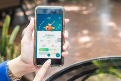 Nakhonratchasima THAILAND September 6 2016 : Pokemon Go app, a f. Ree-to-play augmented reality mobile game developed by Niantic for iOS in public park THAILAND Stock Photo