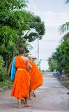 Nakhonsawan,Thailand – October 12: Every day very early in the. Morning, the monks walk the streets to beg give food offerings to a Buddhist monk Stock Photography