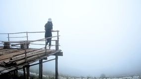 Traveler walking to view point on bamboo bridge to enjoy natural among fog. Traveler woman walking to view point on bamboo bridge to enjoy natural among fog stock video