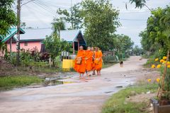 Nakhonsawan,Thailand – October 12: Every day very early in the. Morning, the monks walk the streets to beg give food offerings to a Buddhist monk Royalty Free Stock Image