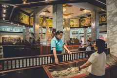Nakhonsawan, Thailand, 29 May 2018: People exploring expositions. Of previous centuries in museum stock image