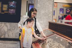 Nakhonsawan, Thailand, 29 May 2018: People exploring expositions. Of previous centuries in museum royalty free stock images