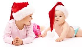 nakrętek dzieci bożych narodzeń czerwony uśmiech dwa target1251_0_ Zdjęcie Stock