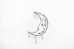 Nakreślenie księżyc z wzorami na białym tle Obrazy Royalty Free