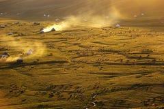 Nalati grässlätt på solnedgången Arkivfoto