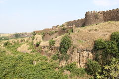 Naldurg Fort. Outer side wall and rock fall of historical Naldurg fort in Osmanabad, India Royalty Free Stock Photos
