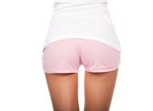 Nalgas de la belleza en pantalones cortos cortos Foto de archivo