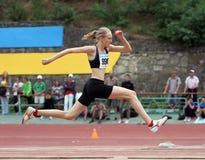Nalivaiko Ylia concurrence dans le saut triple Images libres de droits
