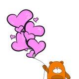 Nallebjörn med ballonghjärtor Arkivbilder