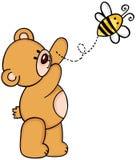 Nallebjörn med biet Arkivfoto