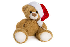 Nallebjörn med den Santa Claus hatten som isoleras på vit bakgrund Arkivfoto