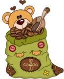 Nallebjörn med påsen av den kaffebönor och skopan Royaltyfri Bild