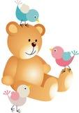 Nallebjörn med tre fåglar Arkivfoto