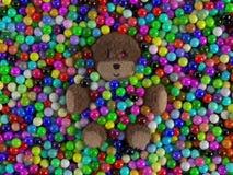 Nallebjörn och bollar Fotografering för Bildbyråer