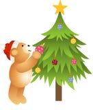Nallebjörn som förlägger glass bollar i julgran Arkivfoton