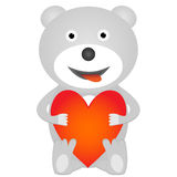 Nallebjörn som rymmer röd hjärta Arkivbild
