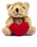 Nallebjörnen leker med hjärta Royaltyfria Foton